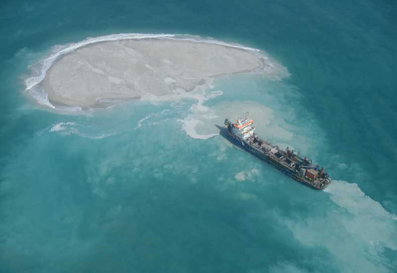Ship building artificial island off the coast of Abu Dhabi